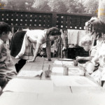Young Kids painting outside