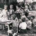 Children at a table outdoors