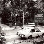 Old cars outside the sign for Pacific Oaks Children's School