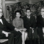 3 men and a woman in sitting