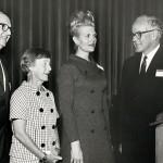 Adults at a podium
