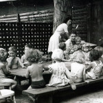 Children in bathing suits at a table outdoors