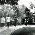 Adults walking on a path toward a building