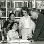 Group of students and teacher gathered in the library