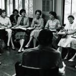 Group of women at desks taking notes