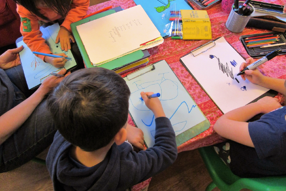 Children in classroom drawing together